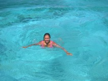 Swimming the clear blue waters.