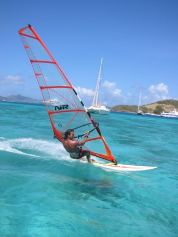 Morgan wind surfing in the Tobago Cayes.