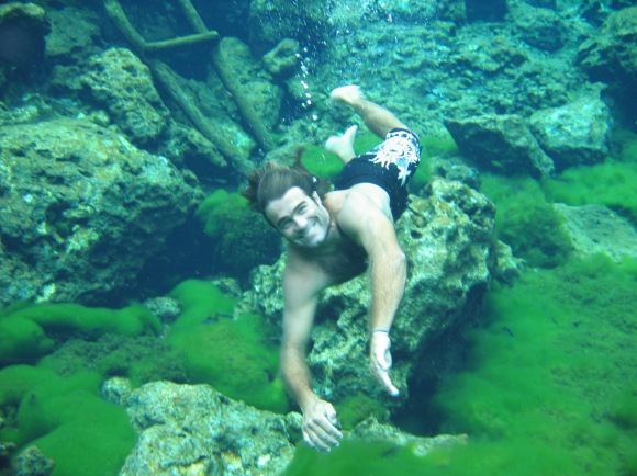 Swimming in the Cenote in Mexico.