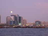 Moon rising over Dubai.