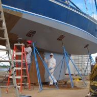 Adding many coats of primer to the hull.