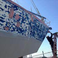 Fairing the hull.