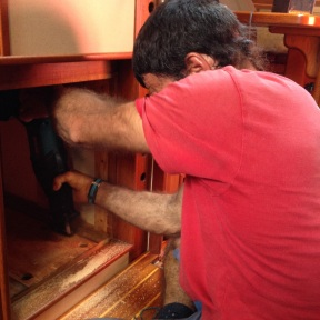Cutting away the cabinetry.