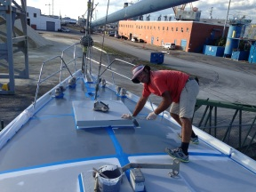 Applying first coat of fresh primer.