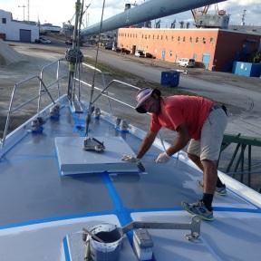 Applying first coat of fresh primer.