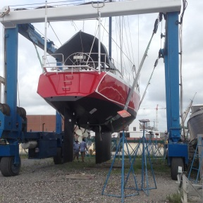 Being lifted to work under the keel.