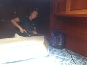 Spot cleaning the mattress.